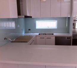 Kitchen Glass Splashback In a white kitchen